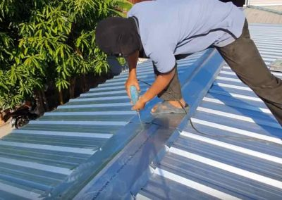 Roofer Fixating Metal Roof in Orlando FL